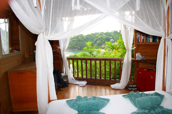Castara Retreats bedroom and view of the bay